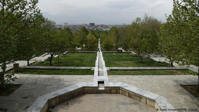 Bagh-e-Babur park in Kabul with an empty fountain, trees, lawns and terraces