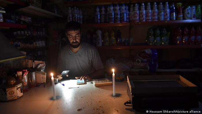 Working at home by candlelight in Lebanon.