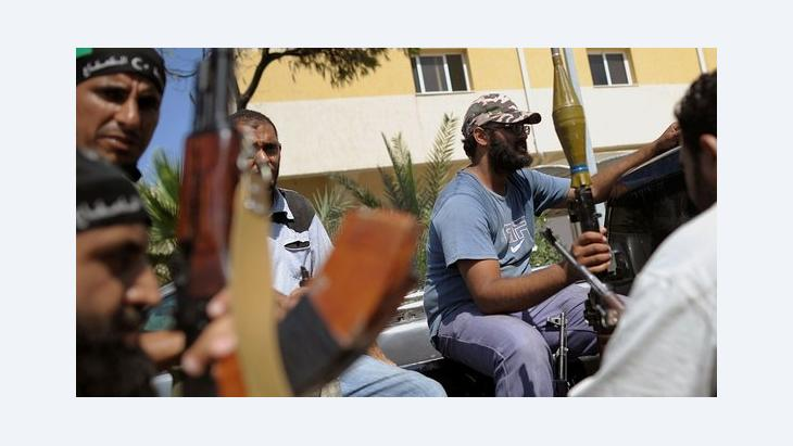 Rebels in Tripoli (photo: picture-alliance/dpa)