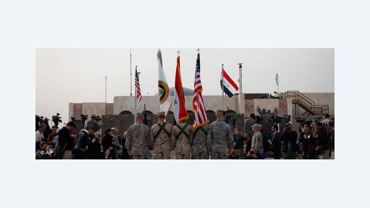 Ceremony in Baghdad marking the end of US military operations in Iraq (photo: AP)