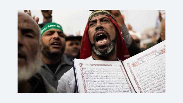 A supporter of Mohamed Morsi holds a Koran during a demonstration in Cairo (photo: AFP/Getty Images)