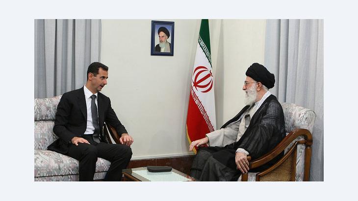 Syria's President Bashar al-Assad speaking to Ayatollah Ali Khamenei during a state visit to Tehran (photo: AP)