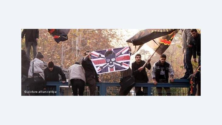 Members of the Basij militia waving anti-British flags as they storm the British embassy in Tehran (photo: dapd)