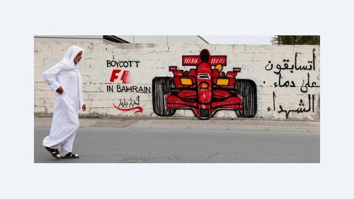 Man passing by anti-Formula One protests mural in Manama, Bahrain (photo: Reuters)