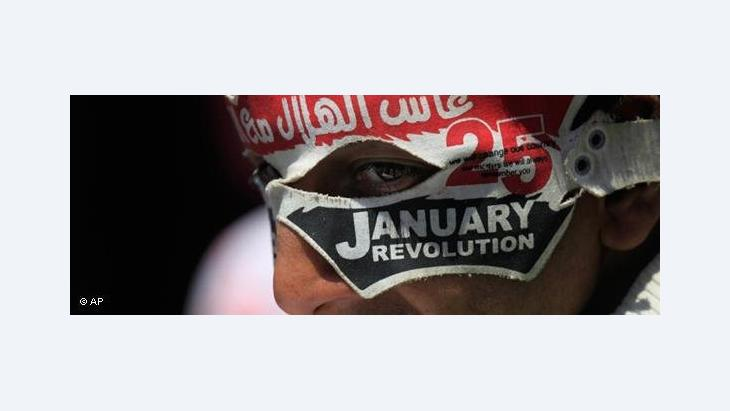 Young person on Tahrir Square wearing a ''25 January'' mask (photo: AP)