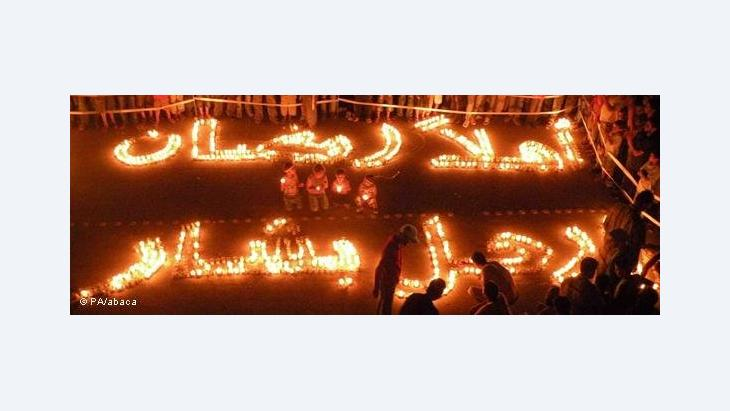 Demonstrators close by the city of Idib are using lighted candles as slogans: 'Welcome Ramadan, Go Bashar' (photo: PA/abaca)