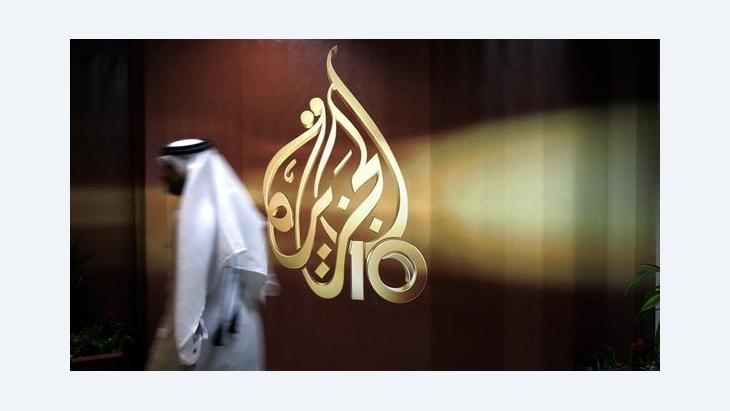 Employee at the Al-Jazeera headquarters in Doha, Qatar (photo: AP)