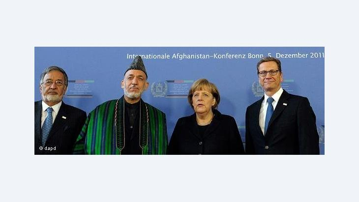Family photo with Hamid Karzai, Angela Merkel and Guido Westerwelle at the Afghanistan Conference in Bonn (photo: dapd)
