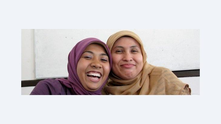 Two women wearing the headscarf (source: Inside Indonesia)
