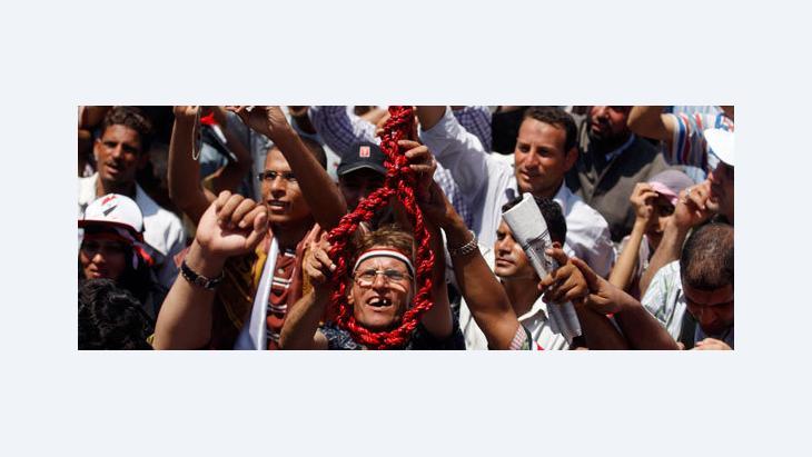 Demonstrator at Tahrir Square in Cairo (photo: AP)