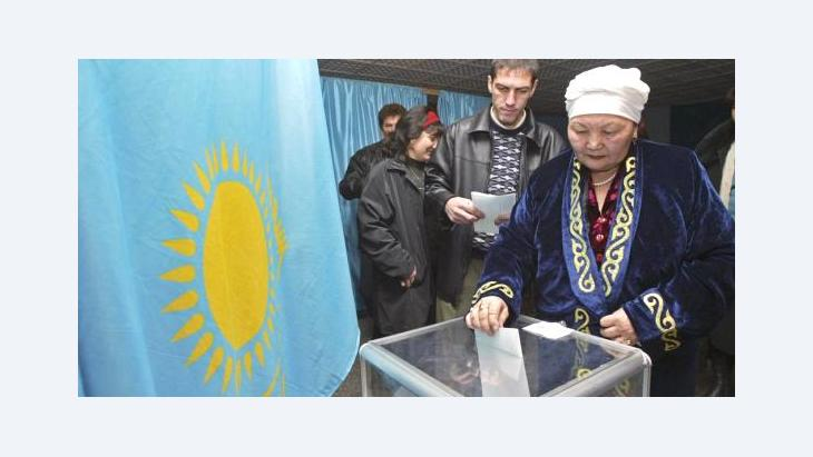 A Kazakh woman casts her ballot at a polling station in the Kazakhstan's commercial capital Almaty (photo: AP)