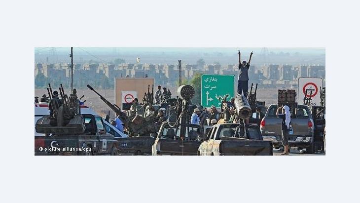 Libyan rebels in front of Sirte (photo: dapd)