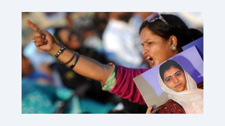 A Pakistani female supporter of a political party Muttahida Quami Movement (MQM) shouts slogans during a protest procession against the assassination attempt by Taliban on child activist Malala Yousafzai in Karachi on October 14, 2012 (photo: AFP/Getty)