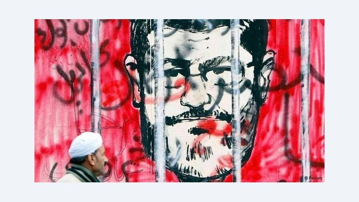 Caricature of president Morsi in Kairo (photo: Reuters)