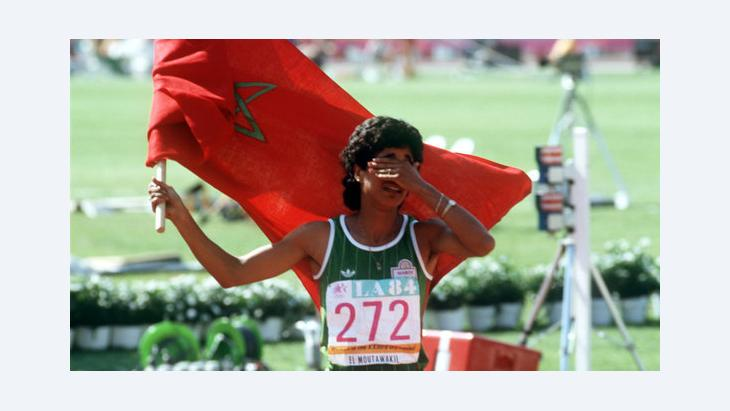 Nawal El Moutawakel after winning a gold medal at the Olympics in 1984 (photo: picture-alliance/dpa)