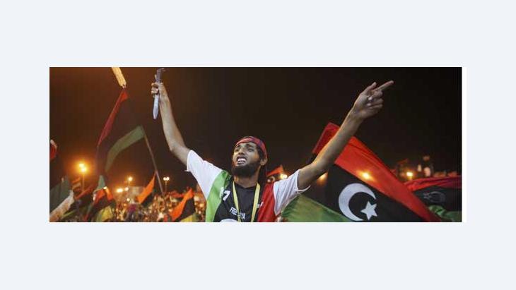 People celebrating in Tripoli (photo: AP)