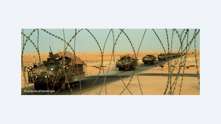 US Troops' withdrawal from Iraq: A column of U.S. Army Stryker armoured vehicles cross the border from Iraq into Kuwait Wednesday, 18 August 2010 (photo: AP)