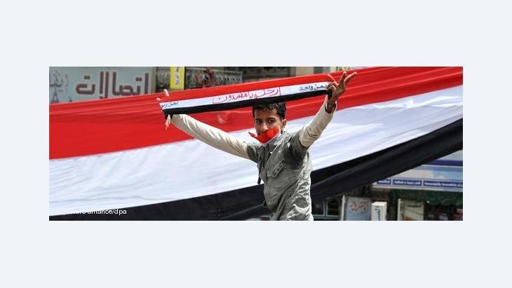 Teenage protestor in Yemen (photo: dpa)