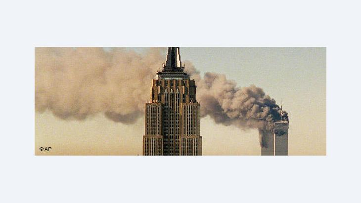 The twin towers after impact on 11 September 2001 (photo: AP)