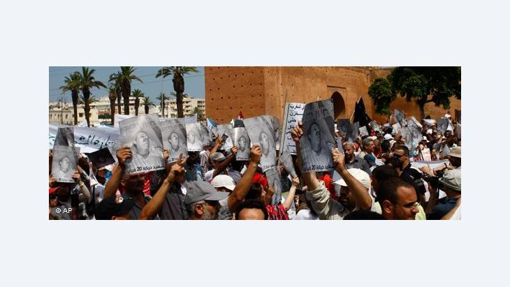 Anti-government protesters shout as they hold a poster of Kamal Al-Amri, pictured, a member of Morocco's main opposition Islamist group who died in June from wounds sustained during a pro-reform demonstration several days earlier, during a rally organized by the 20th February movement in Rabat, Morocco, Sunday June 5, 2011 (photo: AP/Abdeljalil Bounhar)