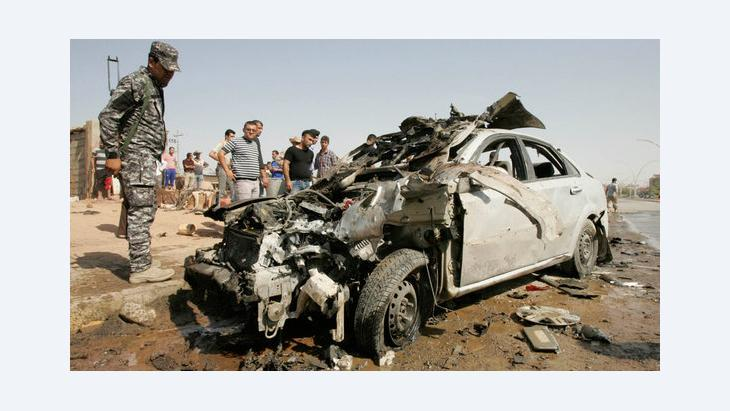 The wreckage of a bombed-out car in Kirkuk, 23 July 2012 (photo: Reuters)