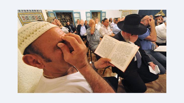 Jewish men pray at the Amram ben Diwan synagogue during a Jewish pilgrimage in northern Morocco (photo: Abdelhak Senna/AFP/GettyImages)