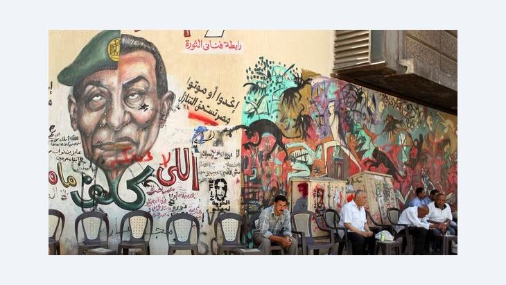 The two faces of the regime: Graffiti on the wall of a café in Cairo showing the faces of Mubarak and Tantawi (photo: Reuters)