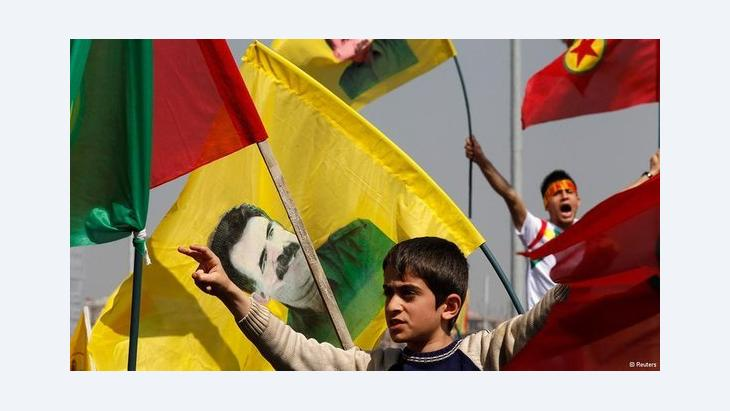 Kurds celebrating the announcement of the PKK peace plan in Diyarbakir (photo: Reuters)