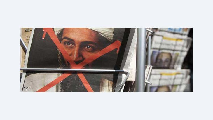 The portrait of Osama Bin Laden crossed out with red colour on a German newspaper (photo: AP)
