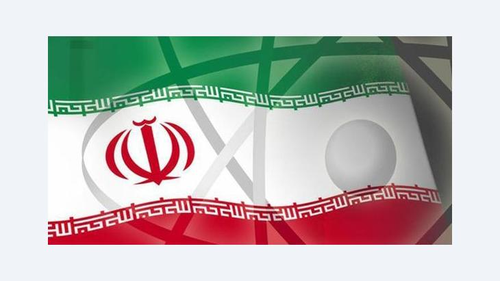 The symbol for nuclear power superimposed on the Iranian flag (source: AP)