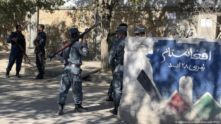 Afghanistan following the attacks on educational institutions: Afghan police guard an entrance to Kabul University