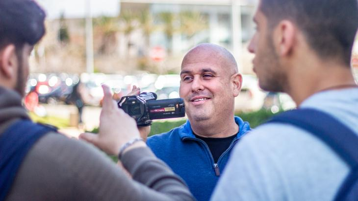 Corey Gil-Shuster, director of the International Program in Conflict Resolution and Mediation at Tel Aviv University, during filming.