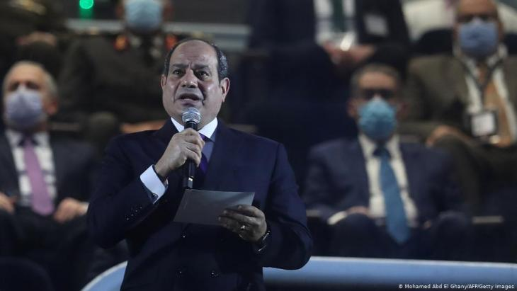 Egyptian president Abdeu Fattah al-Sisi (front) delivers a speech in grandstand before the opening match of the 2021 World Men's Handball Championship between Group G teams Egypt and Chile at the Cairo Stadium Sports Hall in the Egyptian capital on 13 January 2021