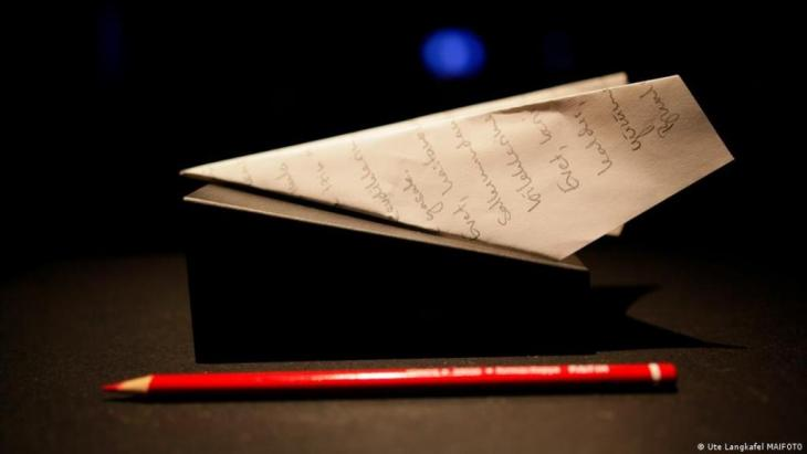 Red pencil and paper aeroplane from Can Dundar's Berlin installation.