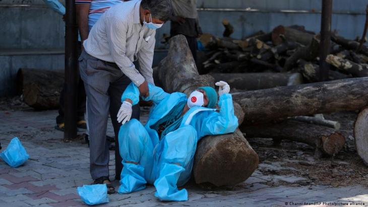 India's crematoriums and burial grounds are being overwhelmed by a devastating surge of infections.