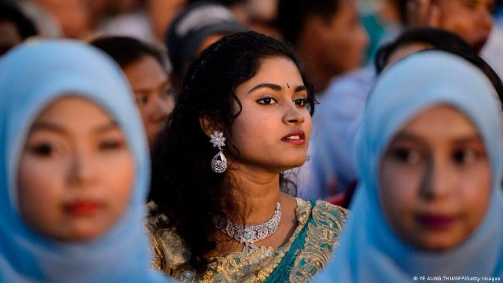 A Hindu girl and Muslim girls take part in an interfaith Prayer for Peace ceremony.