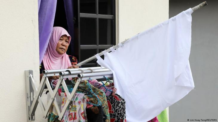 Halijah Naemat, 74, puts away a white flag after she received help from others at her home during an enhanced lockdown, amid the coronavirus disease (COVID-19) outbreak, in Petaling Jaya, Malaysia, 6 July 2021.