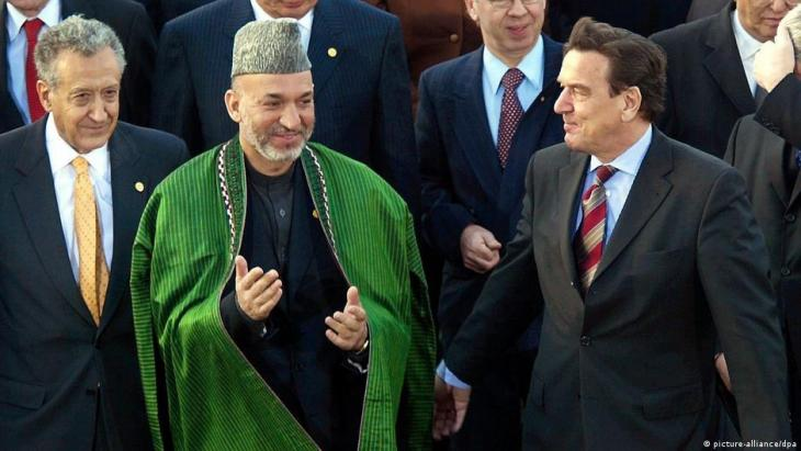 One year after the first conference, the participants from 32 countries took stock of the stabilisation of the war-ravaged country and Karzai presented the goals of his government until the 2004 elections. Schroeder, representatives of the United Nations and the EU promised Afghanistan further support for reconstruction.