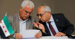 Abdelbasset Sida, leader of the opposition Syrian National Council (R), chats with council member George Sabra during a news conference in Istanbul July 13, 2012 (photo: REUTERS/Murad Sezer)