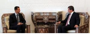 Syrian president al-Assad with Turkish foreign minister Davutoglu (photo: AP)