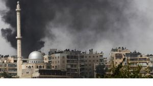 Wads of smoke over the ancient city of Aleppo (photo: Reuters)