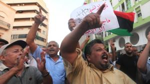 A demonstrator holds banner during a rally to condemn the killers of the U.S. Ambassador to Libya and the attack on the U.S. consulate, in Benghazi September 12, 2012 (photo: Reuters)