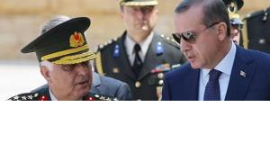 Prime Minister Recep Tayyip Erdogan, right, talks with Gen. Necdet Ozel, Turkey's new Land Forces Commander and acting Chief of Staff, at the mausoleum of modern Turkey's founder Kemak Ataturk, after the military's annual meeting in Ankara, Turkey, Monday, 1 August 2011 (photo: AP)