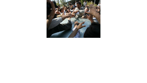 Enthusiastic supporters reaching out to shake the hand of Iranian President Mahmoud Ahmadinejad (photo: AP)