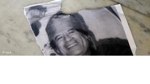 Ripped Gaddafi poster (photo: dapd)