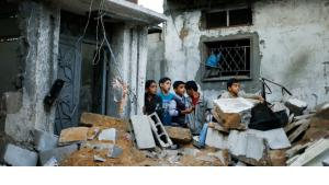 Palestinian boys stand next to the destroyed house of Hejazi family after what Hamas Health Ministry said was an Israeli air strike in the northern Gaza Strip November 20, 2012 (photo: Reuters)