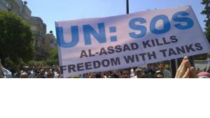 Demonstrators in Homs, Syria, demanding UN intervention (photo: AP)