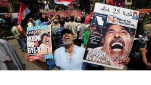 Demonstrator on Tahrir Square after Mubarak's ouster (photo: AP)