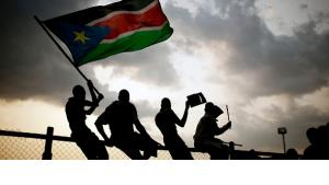 Southern Sudanese wave flags and cheer at the Republic of South Sudan's first national soccer match in the capital of Juba on 10 July 2011, one day after South Sudan declared its independence (photo: AP)