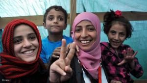 Yemeni women's rights and democracy campaigner Tawakkul Karman, 32, one of the three recipients of the 2011 Nobel Peace Prize, reacts as she receives congratulations from protesters inside her tent at a protester camp in Sana'a, Yemen, 8 October 2011 (photo: dapd)